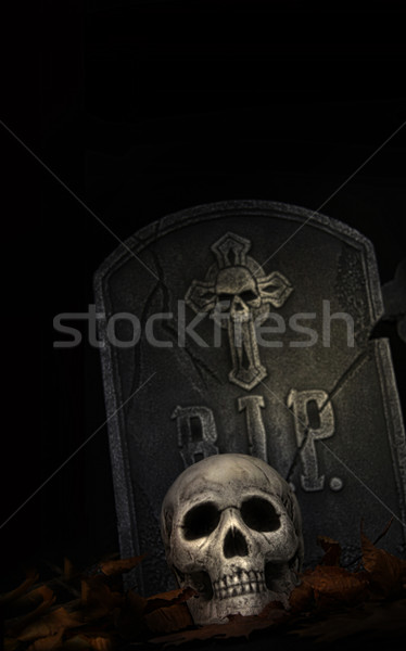 Spooky tombstone with skull on black Stock photo © Sandralise