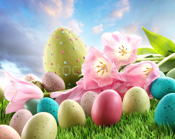 Easter eggs with tulips in the grass  Stock photo © Sandralise