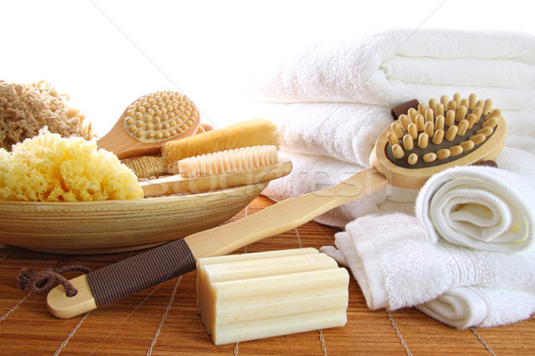 Spa still life of assorted bath brushes and sponges, soap towels Stock photo © Sandralise