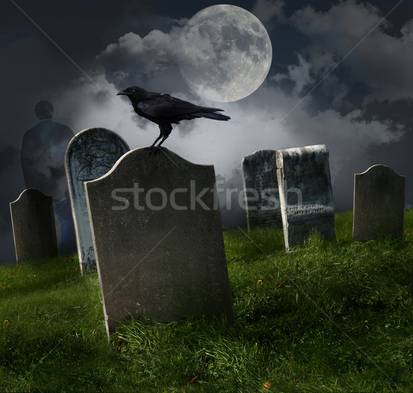 Stock photo: Cemetery with old gravestones and moon