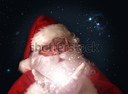 Santa holding magical lights in hands Stock photo © Sandralise