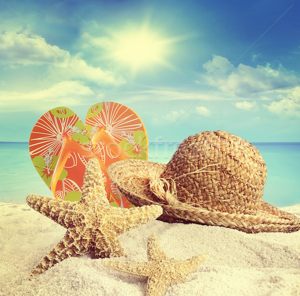 Sandy beach, straw hat and starfish in summer Stock photo © Sandralise