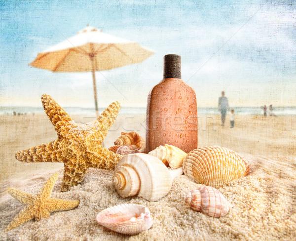 Opalenizna mleczko kosmetyczne muszle plaży ludzi lata Zdjęcia stock © Sandralise