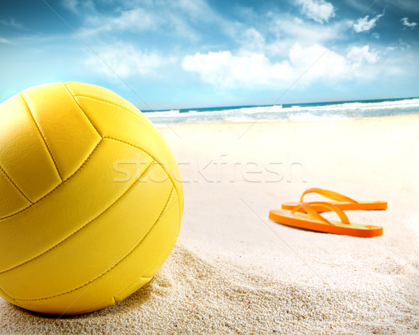 Stock photo: Volleyball in the sand with sandals