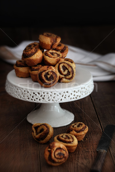 Cinnamon pinwheel rolls on cake stand Stock photo © Sandralise