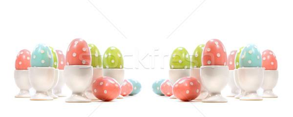 Polka dot easter eggs in cups on white Stock photo © Sandralise