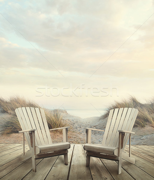 Wooden deck with chairs, sand dunes and ocean Stock photo © Sandralise