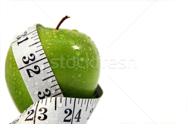 Measurement tape wrapped around green apple Stock photo © Sandralise