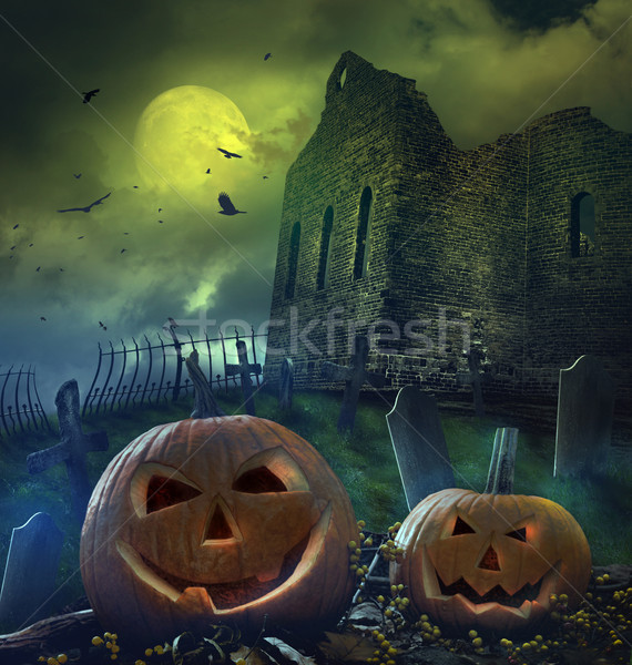 Pumpkins in graveyard with church ruins Stock photo © Sandralise