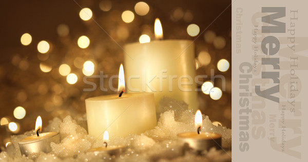 Brightly lit candles in wet snow Stock photo © Sandralise