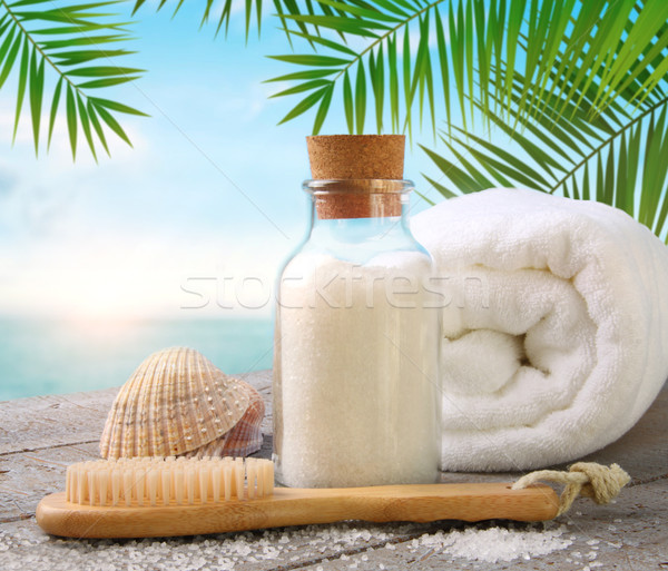 Fluffy towels with sea salt and seashells on beach table Stock photo © Sandralise