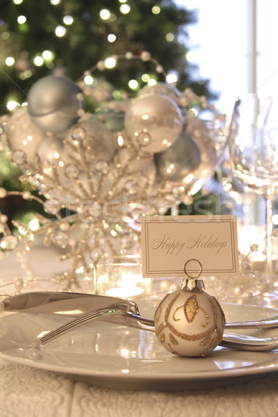 Elegant holiday dinner table with focus on place card Stock photo © Sandralise