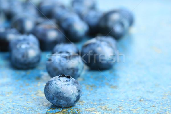 Blueberries on blue background Stock photo © Sandralise