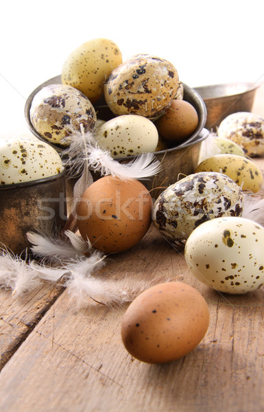 Brown and white speckled eggs on table Stock photo © Sandralise