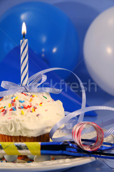 Little cupcake with blue candle Stock photo © Sandralise