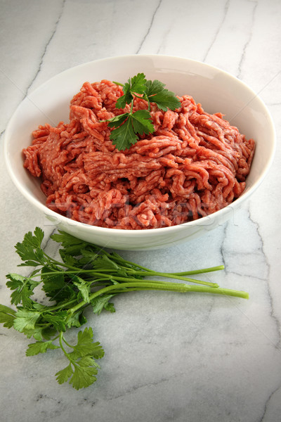 Close up of raw ground beef on cutting board  Stock photo © Sandralise
