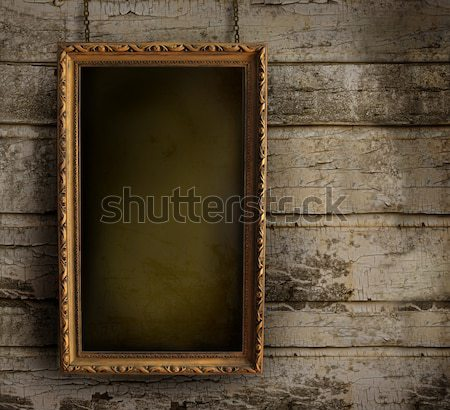 Old frame against a peeling painted wall Stock photo © Sandralise