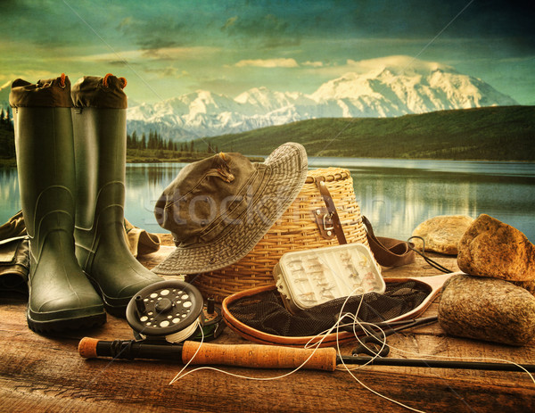 Fly fishing equipment on deck with view of a lake and mountains Stock photo © Sandralise