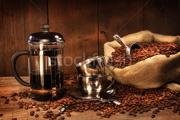 Sack of coffee beans with french press Stock photo © Sandralise