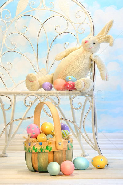 Easter bunny with eggs on chair Stock photo © Sandralise