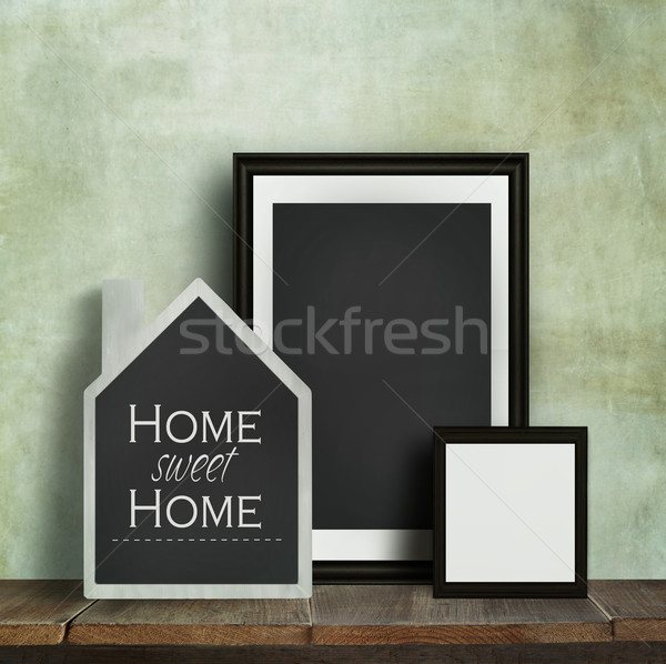 Chalkboard with quote and frames on table Stock photo © Sandralise
