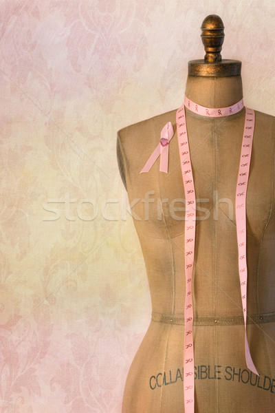 Pink breast cancer ribbon on mannequin with vintage background Stock photo © Sandralise