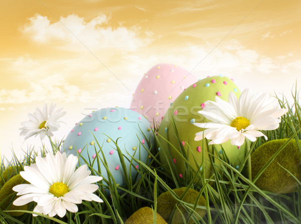 Closeup of decorated easter eggs in the grass with flowers Stock photo © Sandralise