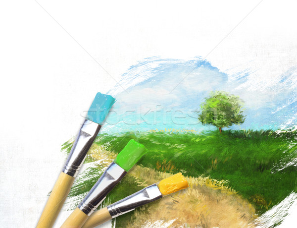 Artist brushes with a half finished painted landscape canvas  Stock photo © Sandralise