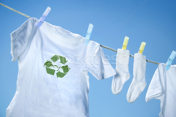 Stock photo: T-shirt with recycle logo drying on clothesline on a  summer day