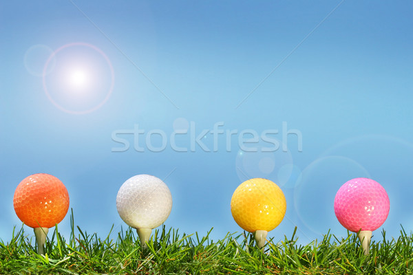 Colored golf balls in the grass Stock photo © Sandralise