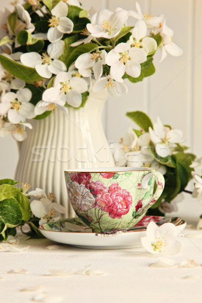 Tea cup with fresh flower blossoms Stock photo © Sandralise
