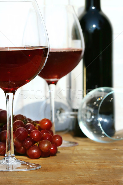 Stock photo: Two glasses of red wine on a table