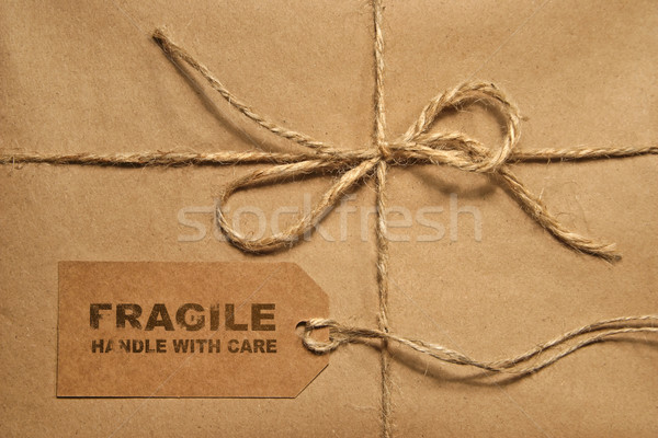 Brown shipping parcel tied with twine and tag for copy space Stock photo © Sandralise