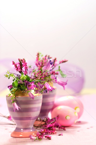 Egg cups with flower decorations Stock photo © Sandralise