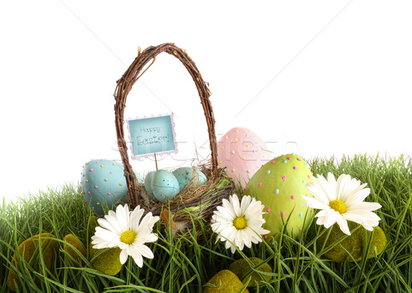 Easter eggs with  basket in the grass Stock photo © Sandralise