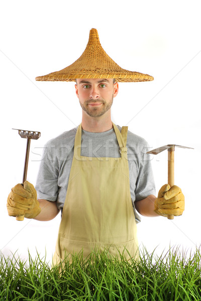 Man with Asian hat and garden tools Stock photo © Sandralise