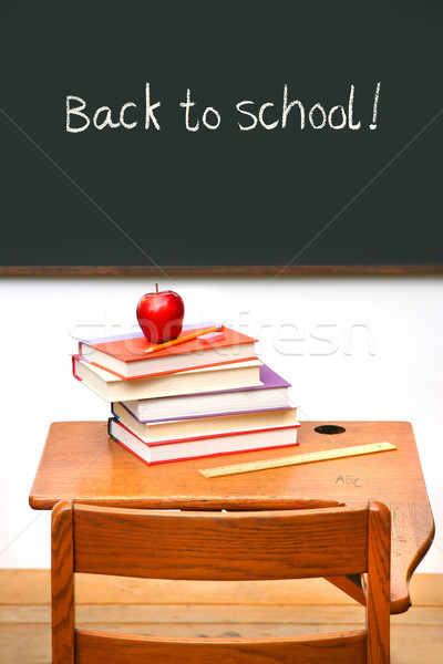 Old school desk with a stack of books Stock photo © Sandralise