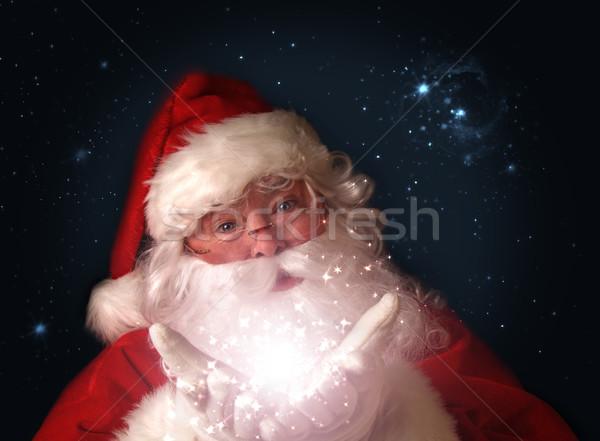 Mikulás tart varázslatos karácsony fények kezek Stock fotó © Sandralise