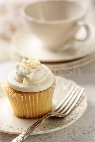Closeup of vanilla cupcake with tea cup Stock photo © Sandralise