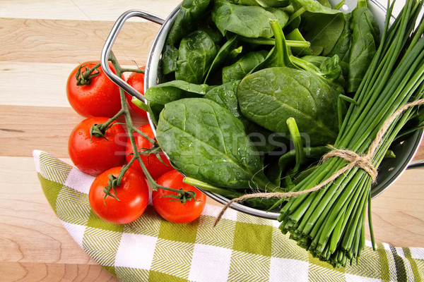 Fresh spinach leaves with tomatoes and strainer Stock photo © Sandralise