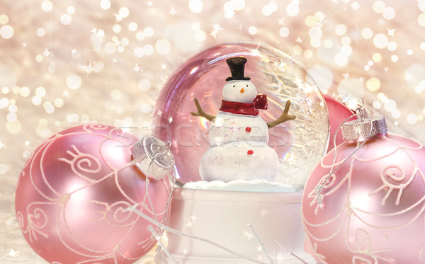 Snow globe with pink ornaments  Stock photo © Sandralise