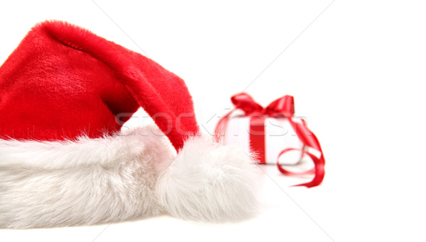 Santa hat and gift with red bow Stock photo © Sandralise
