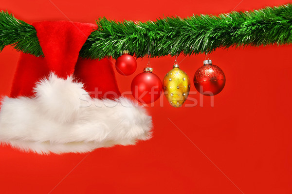 Green garland with santa hat and ornaments Stock photo © Sandralise