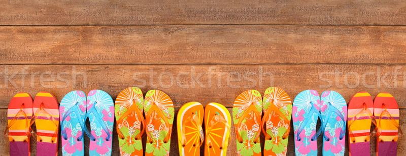 Brightly colored flip-flops on wood  Stock photo © Sandralise