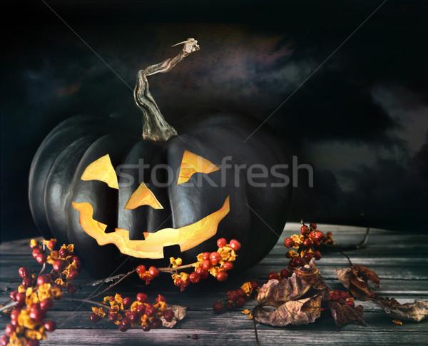 Spooky pumpkin on table Stock photo © Sandralise