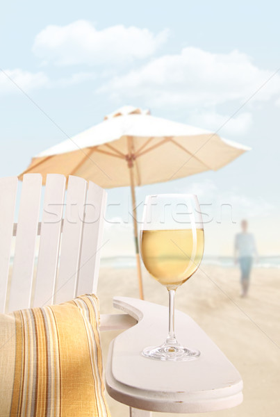 Glass of  wine on adirondack chair at the beach Stock photo © Sandralise
