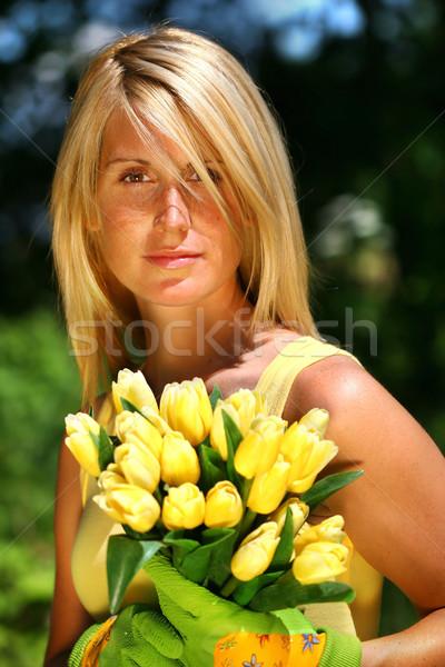 Pretty woman holding  tulips  Stock photo © Sandralise