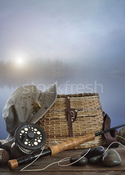 Fly rod with creel and equipment on wood Stock photo © Sandralise