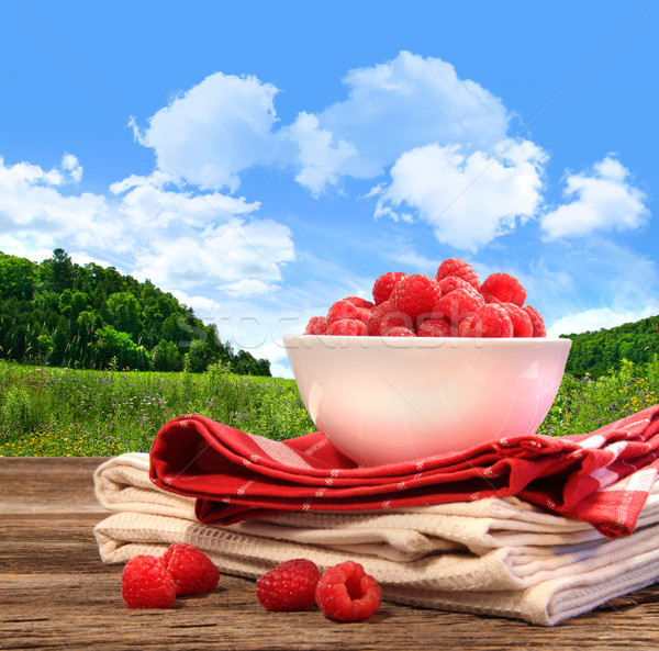 Bowl of raspberries on rustic table  Stock photo © Sandralise