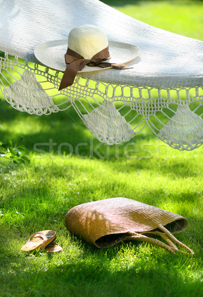 Straw hat with brown ribbon laying hammock Stock photo © Sandralise